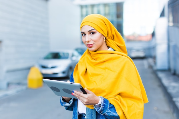 Beautiful muslim woman with tablet