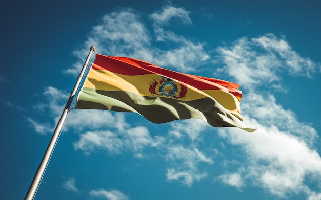 Beautiful national state flag of bolivia fluttering at sky background.