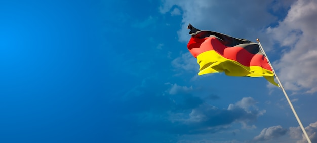 Beautiful national state flag of germany with blank space on wide background