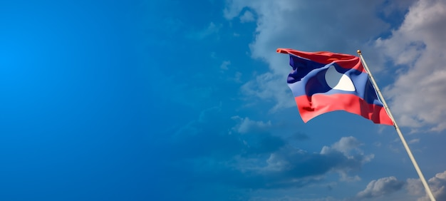 Beautiful national state flag of laos with blank space on wide background