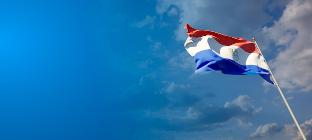 Beautiful national state flag of paraguay on blue sky