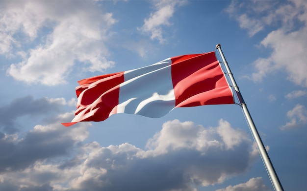 Beautiful national state flag of peru fluttering on blue sky