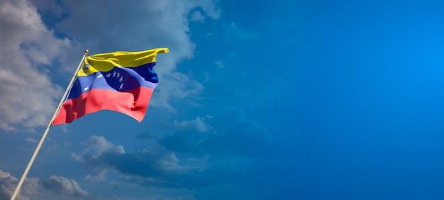 Beautiful national state flag of venezuela on blue sky