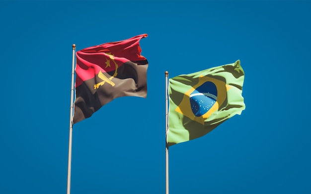 Beautiful national state flags of brasil and angola together on blue sky
