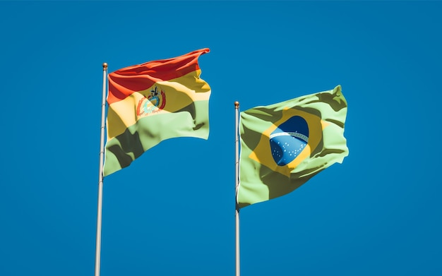 Beautiful national state flags of brasil and bolivia together on blue sky