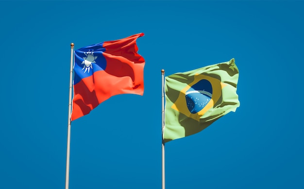 Beautiful national state flags of brasil and taiwan together on blue sky