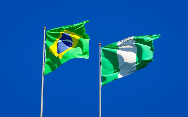 Beautiful national state flags of brazil and nigeria together on blue sky