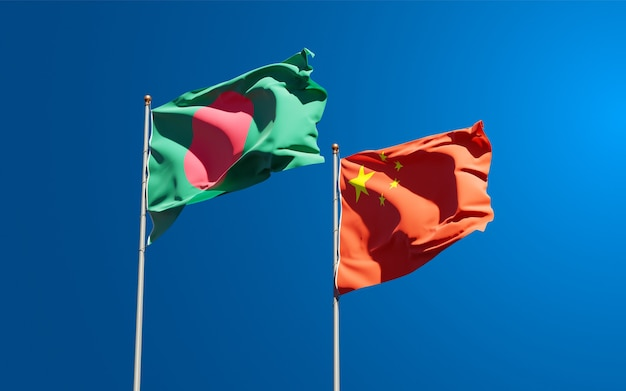 Beautiful national state flags of china and bangladesh together at the sky
