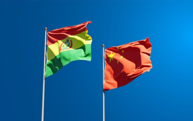 Beautiful national state flags of china and bolivia together at the sky