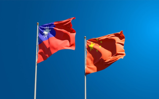 Beautiful national state flags of china and taiwan together at the sky