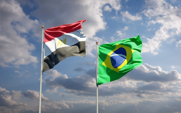 Beautiful national state flags of egypt and brasil together on blue sky
