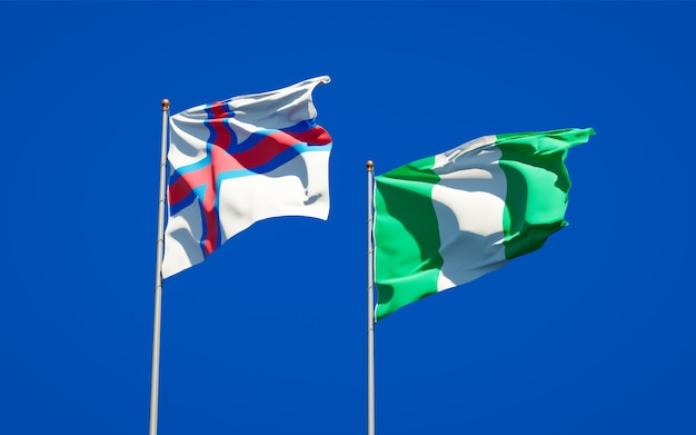 Beautiful national state flags of faroe islands and nigeria together on blue sky