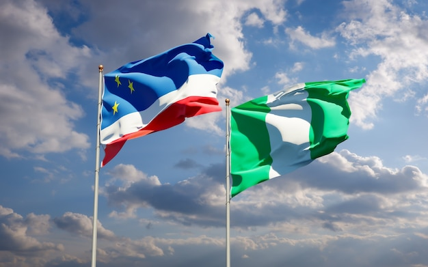 Beautiful national state flags of gagauzia and nigeria together on blue sky
