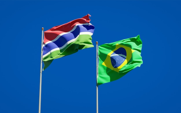 Beautiful national state flags of gambia and brasil together on blue sky