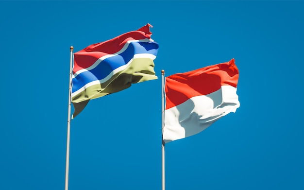 Beautiful national state flags of gambia and indonesia together on blue sky