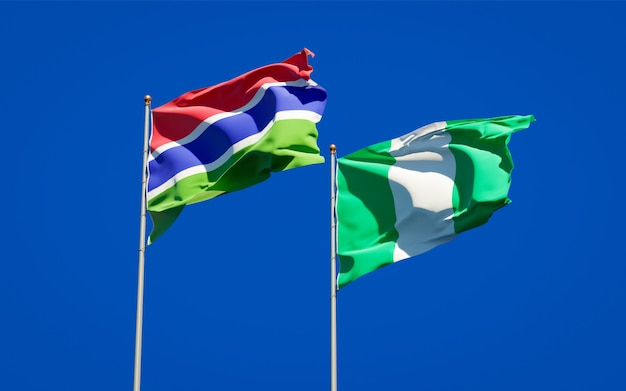 Beautiful national state flags of gambia and nigeria together on blue sky