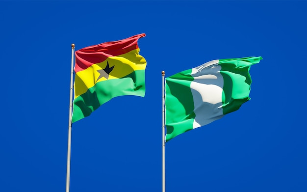 Beautiful national state flags of ghana and nigeria together on blue sky