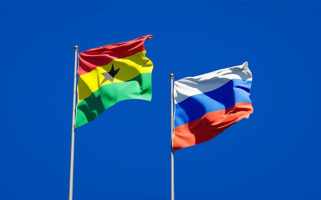 Beautiful national state flags of ghana and russia together on blue sky. 3d artwork
