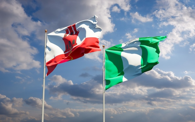 Beautiful national state flags of gibraltar and nigeria together on blue sky