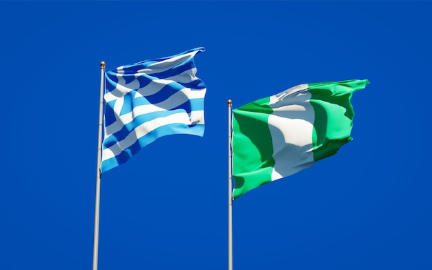 Beautiful national state flags of greece and nigeria together on blue sky