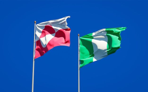 Beautiful national state flags of greenland and nigeria together on blue sky