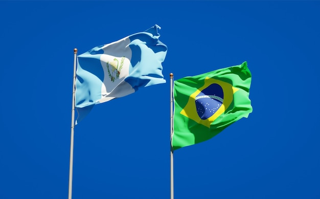 Beautiful national state flags of guatemala and brasil together on blue sky