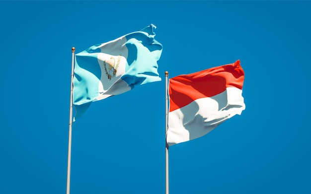 Beautiful national state flags of guatemala and indonesia together on blue sky