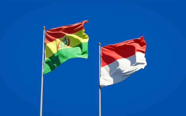 Beautiful national state flags of indonesia and bolivia together on blue sky