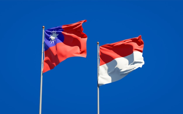 Beautiful national state flags of indonesia and taiwan together on blue sky