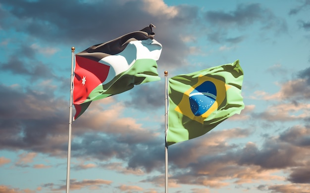 Beautiful national state flags of jordan and brasil together on blue sky