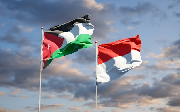 Beautiful national state flags of jordan and indonesia together on blue sky