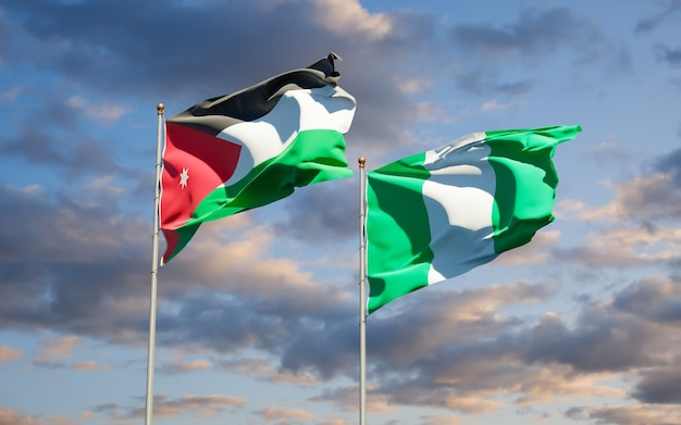 Beautiful national state flags of jordan and nigeria together on blue sky