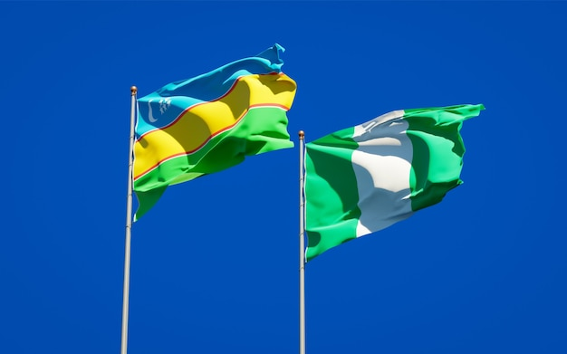 Beautiful national state flags of karakalpakstan and nigeria together on blue sky