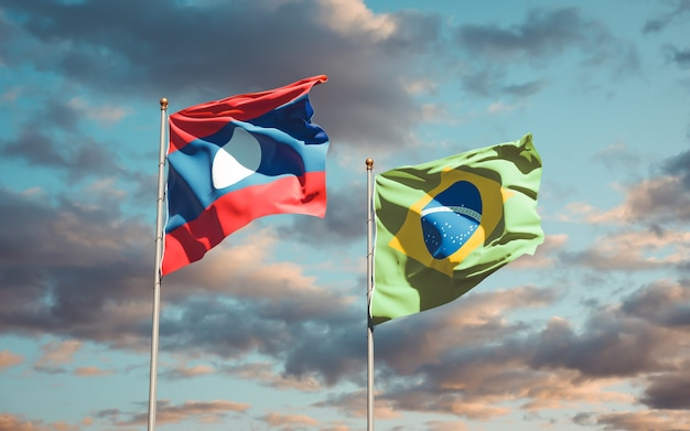 Beautiful national state flags of laos and brasil together on blue sky
