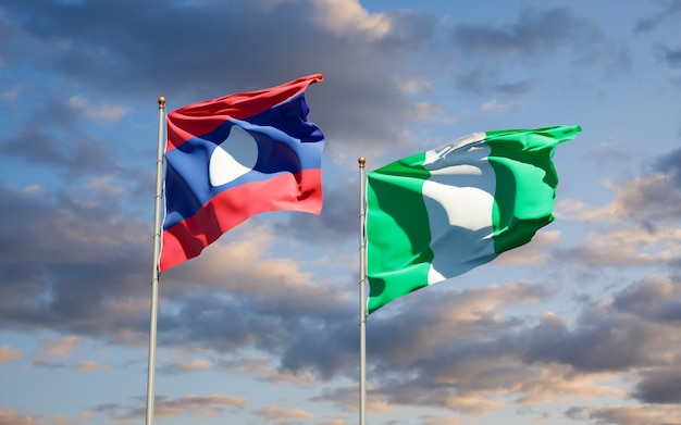 Beautiful national state flags of laos and nigeria together on blue sky