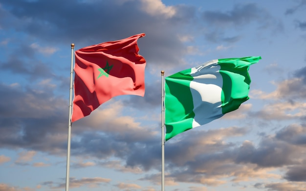 Beautiful national state flags of morocco and nigeria together on blue sky