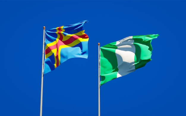 Beautiful national state flags of nigeria and aland islands together on blue sky