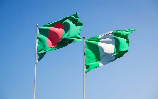 Beautiful national state flags of nigeria and bangladesh together on blue sky