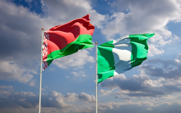 Beautiful national state flags of nigeria and belarus together on blue sky