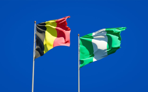 Beautiful national state flags of nigeria and belgium together on blue sky