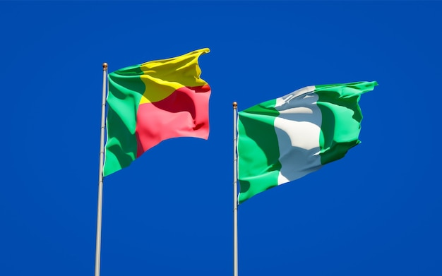 Beautiful national state flags of nigeria and benin together on blue sky