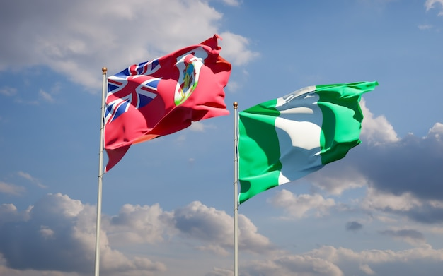 Beautiful national state flags of nigeria and bermuda together on blue sky
