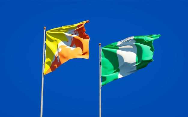 Beautiful national state flags of nigeria and bhutan together on blue sky