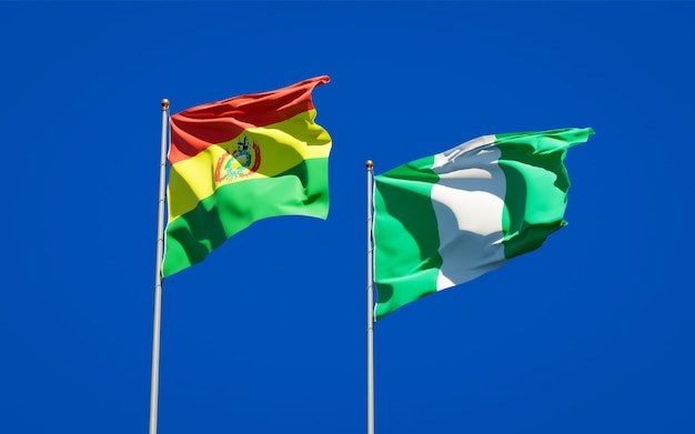 Beautiful national state flags of nigeria and bolivia together on blue sky