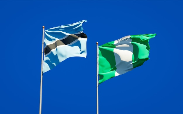 Beautiful national state flags of nigeria and botswana together on blue sky
