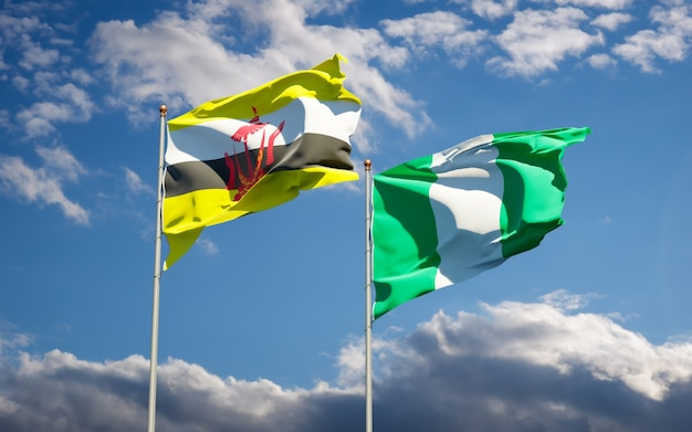 Beautiful national state flags of nigeria and brunei together on blue sky