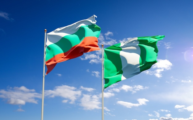 Beautiful national state flags of nigeria and bulgaria together on blue sky