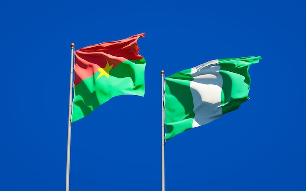 Beautiful national state flags of nigeria and burkina faso together on blue sky
