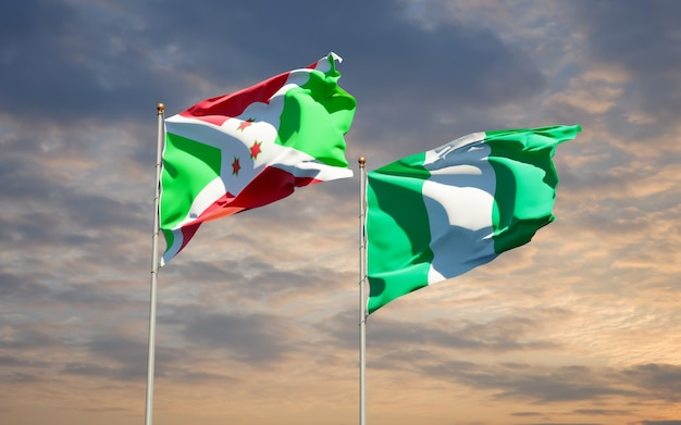 Beautiful national state flags of nigeria and burundi together on blue sky
