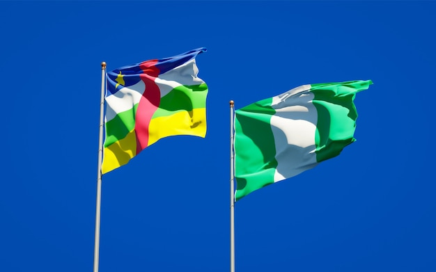 Beautiful national state flags of nigeria and car central african republic together on blue sky